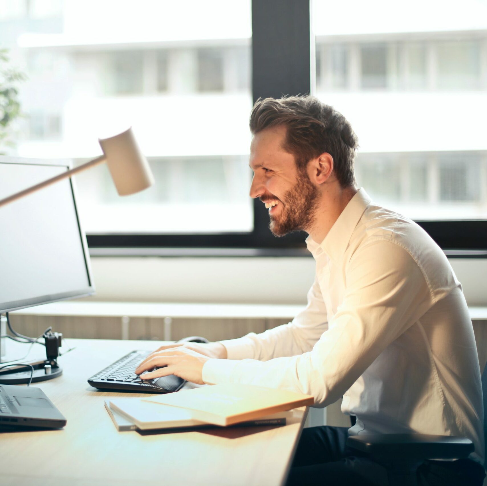 smiling man working in the office